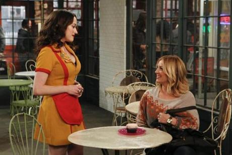 "Kat Dennings (left) and Abby Elliott in a scene from the second season of ""2 Broke Girls."""